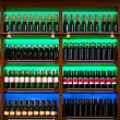 Stock Photo: Shelf with wine bottles