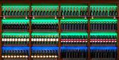 Shelf with wine bottles — Stock Photo