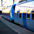 Blue commuter train — Stock Photo