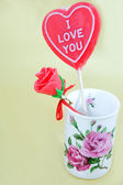 Man-made candy rose in vase — Stock Photo
