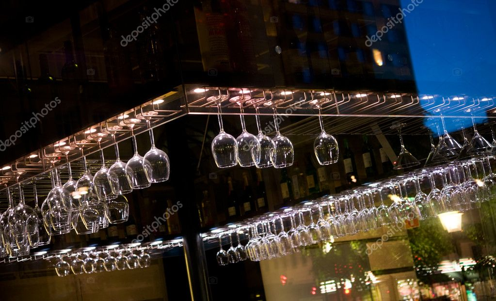 Wine or beer glasses hanging over a bar counter — Stock Photo #8095062