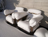 Wooden chairs with snow — Stock Photo
