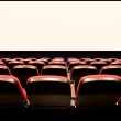 Empty red seats in a cinema — Stock Photo