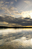 Snset with clouds reflected in water — Stock Photo