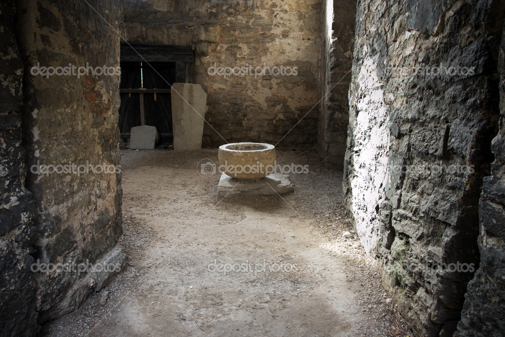 Ancient vessel in sparse light in a medieval church — Stock Photo #8243368