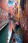 Canal with gondola — Stock Photo