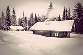 Vintage log cabin in snow — Stock Photo