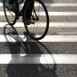 Cyclist on pedestrian crossing — Stok fotoğraf