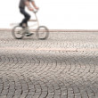 Stock Photo: Cyclist on small bike
