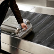 Stock Photo: Suitcase on conveyor belt