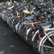 Row of parked bicycles — Stock Photo #9817643
