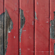Wall with flaking red paint — Stock Photo