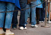 Queue with legs — Stock Photo