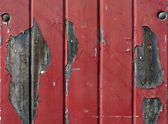 Wall with flaking red paint — Foto Stock