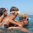 Happy family having fun in the sea — Stock Photo