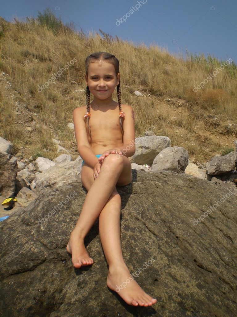 Want girl sitting on rock