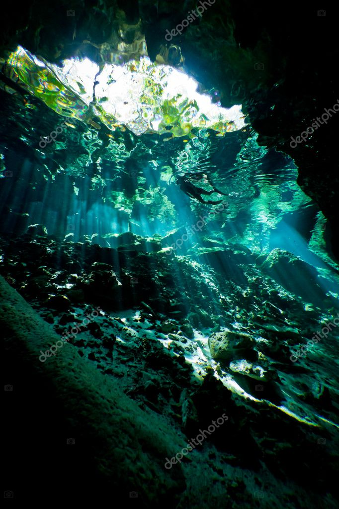 Silhouette of a lone female snorkeler from inside an underwater cave system in Mexico. — Stock Photo #10193578