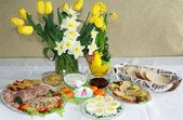 Festive blessed food on Sunday Easter table — Stock Photo