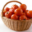 Red tomatoes in basket - Stock Photo