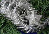 Silver decorations on Christmas tree — Stockfoto