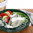 Marinaded herrings as snack — Stock Photo