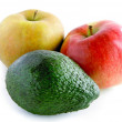 Avocado green fruit and apples — Stock Photo