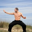Young male fighter exercise outdoor — Stock Photo #10455847
