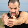 Male bodyguard with a gun — Stock Photo #10456065