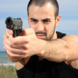Male bodyguard with a gun — Stock Photo #10456130
