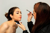 Make up artist and model — Stock Photo