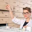 Young girl pharmacist — Stock Photo