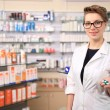 Stock Photo: Young female pharmacist