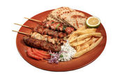 Meat skewers on a plate — Stock Photo