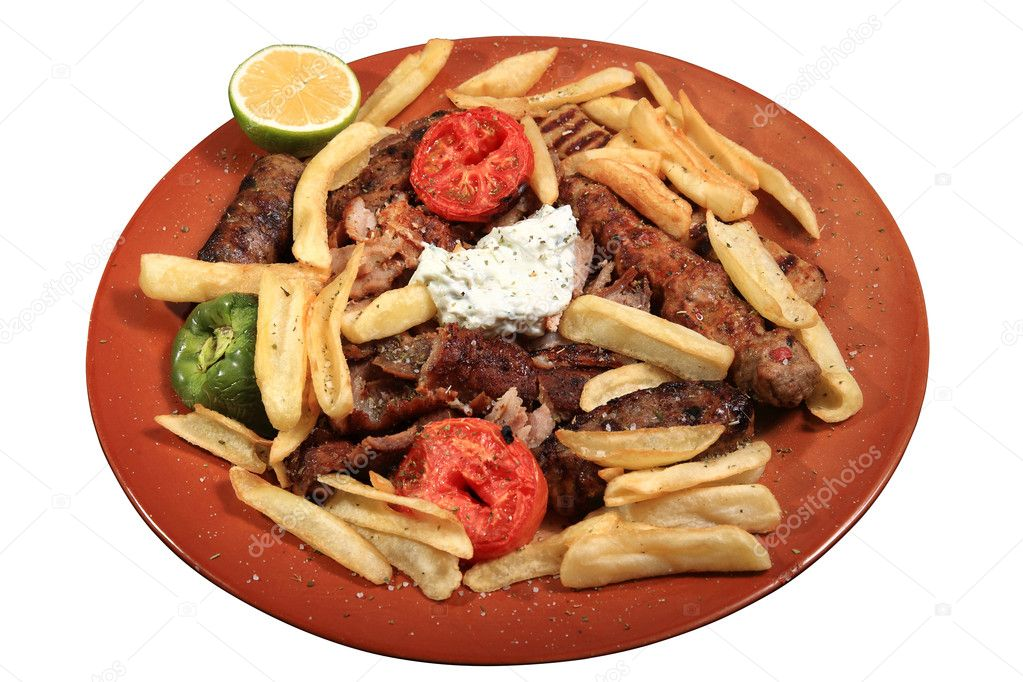 Kebab served on plate  with fries tomato and tzatziki — Stock Photo #9643795