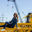Girl on a construction site — Stock Photo