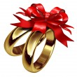 Wedding Rings Tied With A Red Bow - Stock Photo