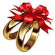 Wedding Rings Tied With A Red Bow — Stock Photo #10534515