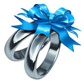 Wedding Rings With a Blue Gift Bow — Stock Photo