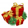 Christmas gifts with pine holly — Stock Photo