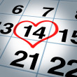 Calendar Page With a Heart On Saint Valentines Day - Stock Photo