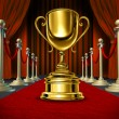 Golden Cup On a red Carpet with velvet Curtains - Stock Photo