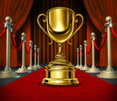 Golden Cup On a red Carpet with velvet Curtains — Stock Photo