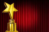 Kırmızı perdeleri üzerinde yıldız ödülü — Stok fotoğraf