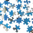 Stock Photo: Puzzles dispersed on white background.