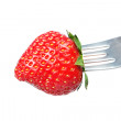 Fresh strawberry on a fork. On a white background. — Stock Photo