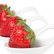 Group of strawberries on a porcelain spoon. — Стоковая фотография