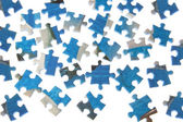 Puzzles dispersed on a white background. — Stock Photo