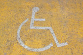 Parking sign for disable on the road — Stok fotoğraf