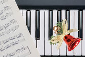 Christmas bell on keyboard — Stock Photo