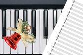 Christmas bell on keyboard — Stock Photo